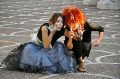 Street theatre in Italy. Street theatre in Pontedera,  Italy . two young actresses play a scene on the streets of a small town . street art concept Royalty Free Stock Image
