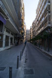 Street in Thessaloniki. With closed shops and motorbikes Stock Photo