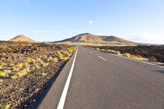 Street throug volcanic landscape in the Timanfaya national park in Lanzarote Stock Photography