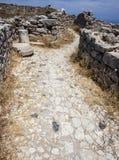 Street thrrugh upper ruins at Ancient Thira, Santorini Stock Images