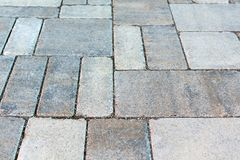 Street tiled stone pavement as bacground. perspective distortion effect stock photos