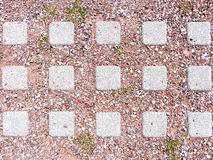 Street tiles with red clay and pebbles close up. Royalty Free Stock Image