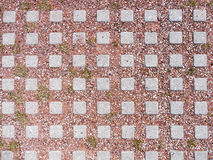 Street tiles with red clay and pebbles close up.  Royalty Free Stock Photos