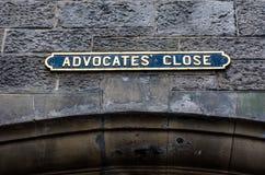 Street title - Advocate close - on the streets of Edinburgh. Stone walls royalty free stock photo