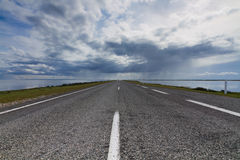 Street to horizon. A street to horizon with a cloudy sky Royalty Free Stock Image