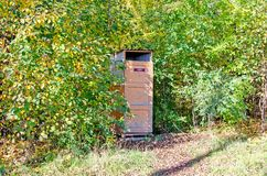 Street toilet in the public park. the inscription on the door is `toilet`. Russia. Siberia stock photo