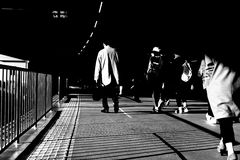 Street in Tokyo. People on their way home. The light of the sunset shined their pace Royalty Free Stock Photo