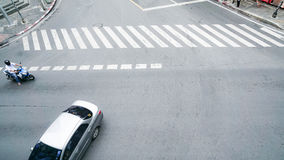 Street on the top view with the crosswalk sign on the road. Stock Photos