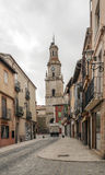 Street of Toro. Street with houses located in Toro Spanish city in Spain, is a cloudy day. It is a picture vertically, you can see the tower bell of the gothic royalty free stock images