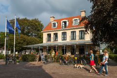 Street with tourists and hotel on the island Schiermonnikoog, Ne Royalty Free Stock Photos