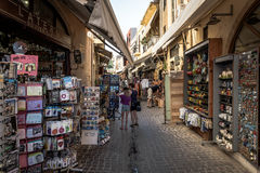 Street with tourists and souvenir shops in city of Chania on Crete island, Greece Royalty Free Stock Images