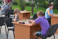 Street tournament on chess on a holiday day of the athlete. Tyum Stock Image