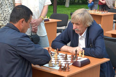 Street tournament on chess on a holiday day of the athlete. Tyum Royalty Free Stock Image