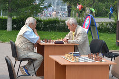 Street tournament on chess on a holiday day of the athlete. Tyum Royalty Free Stock Images