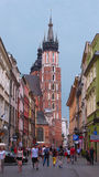A street with a tower of the St. Mary's Church in Krakow, Poland Stock Images