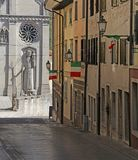 Street of the town of GEMONA in North Italy with Italian flags Royalty Free Stock Photo