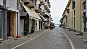 Street in the town of Preveza, Greece. This interesting street leads to the port of Preveza. Photos of the year 01.05.2016 was filmed Stock Photography