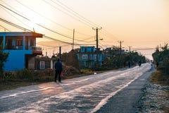 Street through town at sunset