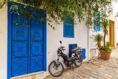 Street in a town in Tunisia. Traditional street with decorated doors in a Tunisian town stock photos