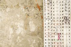 Street trade in Tirana. Glasses exposed for sale in a street of Tirana, placed on a grunge wall Stock Photo