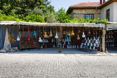 Street trade in traditional Turkish clothes, souvenirs and gifts along the way Royalty Free Stock Image