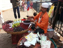 Street trader. Local man selling his goods Royalty Free Stock Photo