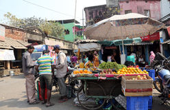 Street trader sell fruits, Kolkata. Street trader sell fruits outdoor on February 10, 2014 in Kolkata India. Only 0.81% of the Kolkata`s workforce employed in Royalty Free Stock Images