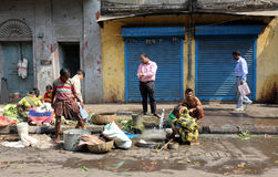 Street trader sell vegetables. Outdoor on February 12, 2014 in Kolkata India. Only 0.81% of the Kolkata`s workforce employed in the primary sector agriculture Royalty Free Stock Photo