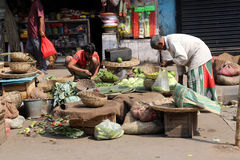 Street trader sell vegetables. Outdoor on February 12, 2014 in Kolkata India. Only 0.81% of the Kolkata`s workforce employed in the primary sector agriculture Stock Photography