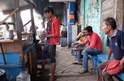 Street trader sells fast food for hungry people on the busy street in Kolkata. India Royalty Free Stock Photo