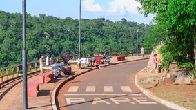 Street traders selling handicraft products on the street on the. Puerto Iguazu, Argentina - January 07, 2018: Street traders selling handicraft products on the Royalty Free Stock Photos