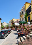 Street with traditional architecture of Chania town on Crete island. Royalty Free Stock Photo