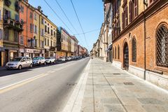Street with traditional buildings in the center of Parma royalty free stock image