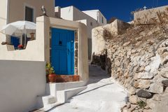 Street in traditional Cyclades style Emporio village Stock Photos