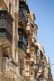 Street with Traditional maltese balconies. Traditional wooden balconies warm sunlight, Valletta, Malta, June 2016 Stock Photography