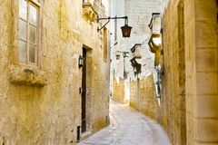 Street with traditional maltese buildings in Mdina Stock Images