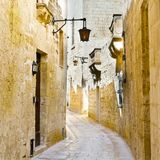 Street with traditional maltese buildings in Mdina. Narrow street with traditional maltese buildings in historical part of Mdina. The city was founded as Maleth Royalty Free Stock Photography