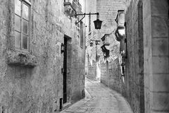 Street with traditional maltese buildings in Mdina. Narrow street with traditional maltese buildings in historical part of Mdina. The city was founded as Maleth Royalty Free Stock Images