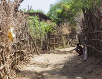 Street in traditional village of Dassanech tribe. Omorato, Ethiopia. Royalty Free Stock Photography