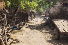 Street in traditional village of Dassanech tribe. Omorato, Ethiopia. Stock Image