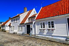 Street with traditional white houses, Norway Stock Images