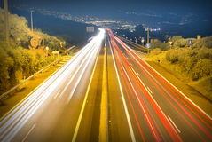 Street traffic at night - long exposure car lights on street Stock Photos