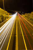 Street traffic at night - long exposure car lights on street Stock Image