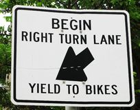 Right Turn Yield To Bikes Sign. Street and Traffic sign of Begin Right Turn Lane with an Arrow and Yield To Bikes Sign royalty free stock images