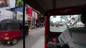 Street traffic and TucTuc ride in Colombo Sri Lanka stock footage