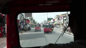 Street traffic and TucTuc ride in Colombo Sri Lanka stock video footage