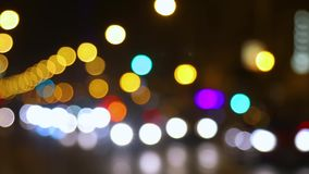 Street trafic blurry background. Defocused lights of traffic on a street stock video