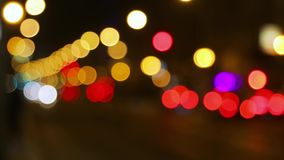 Street trafic blurry background. Defocused lights of traffic on a street stock video footage