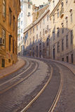 Street with tramway rails in Lisbon Stock Photos