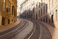 Street with tramway rails in Lisbon Royalty Free Stock Image